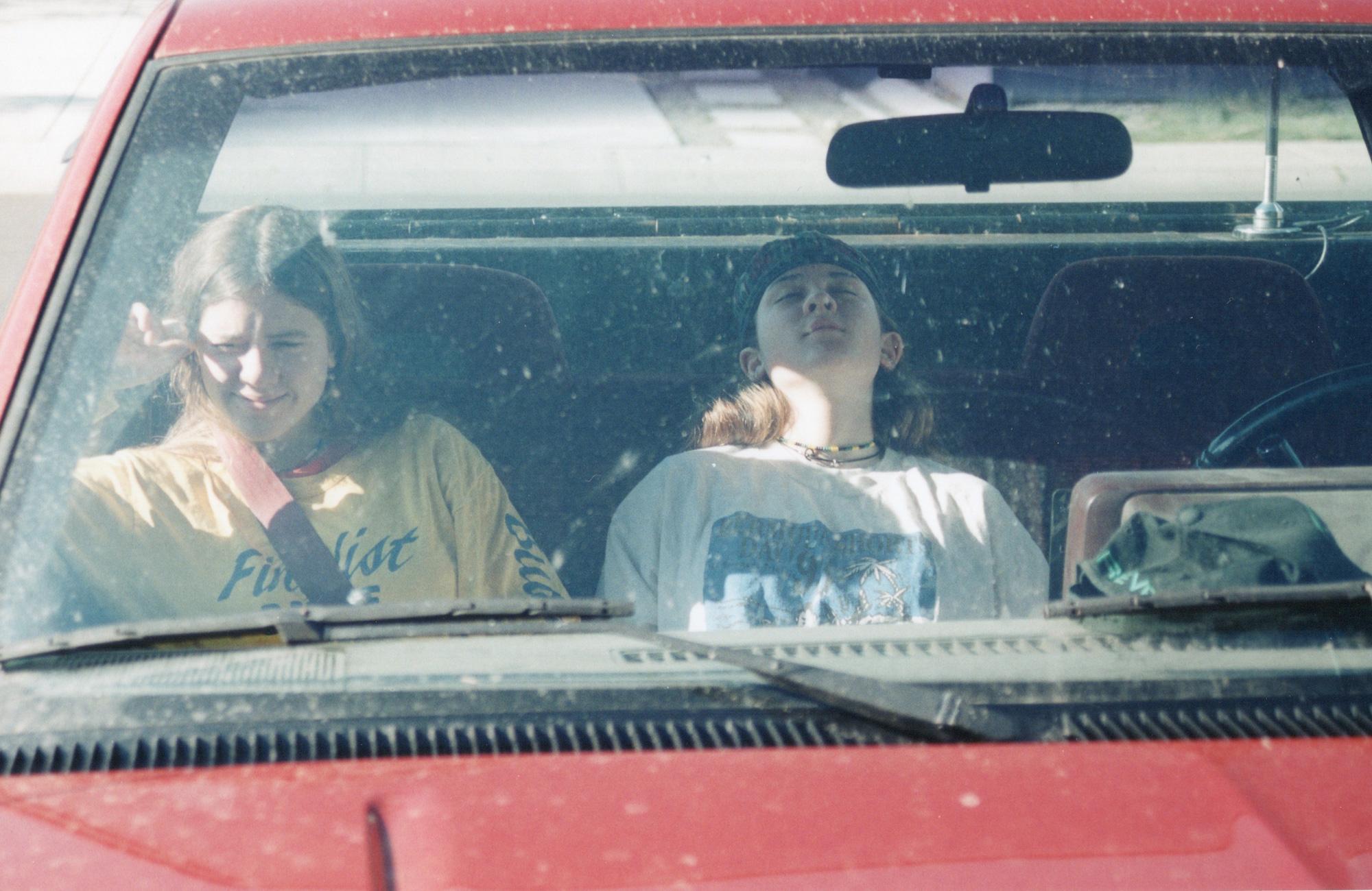 High school Tegan and Sara sitting in a car
